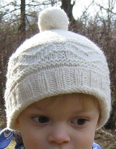 Free Knitting Pattern for Gansey Hat - This easy pompom beanie hat is sized for children but some knitters have adapted for adults by adding repeats. Designed by Christiane Burkhard of LISMI Knits