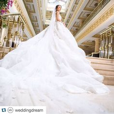 #bride #weddingdress #princess superb white gown from @michael5inco truly spells extravagance out loud! We love how endearing the long train is overwhelming without being over the top! Who wants to wear something like this for your big day? Say ' I do' below and tag someone who would absolutely love this!