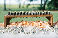 20 Raw Bars Perfect for Your Summer Wedding This year a wedding trend has been a raw bar with oysters, sushi, and shrimp. We have combines 20 raw bar inspirational food ideas for your wedding day. Your guests will love this cool reception appetizer! Wedding Food Bars, Wedding Food Stations, Wedding Reception Food, Wedding Catering, Wedding Menu, Wedding Blog, Wedding Invitations, Southern Wedding Food, Unique Wedding Food