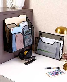 Keep important documents organized and easy to access in this Magnetic Mesh File Holder. The attractive black holder features strong magnets to hold it in place
