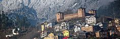 A view of 300 years old historical fort with fresh snow coated Siwazdhar range in the back ground in Bhaderwah in Doda district on Tuesday. (UNI)