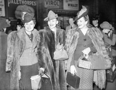 Models leave London for South America to exhibit British fashions, 15th March 1941: The models left from a London station, complete with gas masks in silk handkerchiefs which they will leave behind at the dock. (Photo by Planet News Archive/SSPL/Getty Images)