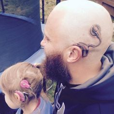This is Alistair Campbell, father of six-year-old Charlotte. Charlotte has two cochlear implants to help her hearing - and in a heartwarming move of Father-of-the-Year proportions, Alistair now has one too.   This Dad Got A Tattoo Of A Cochlear Implant To Match His Daughter's And It's The Sweetest
