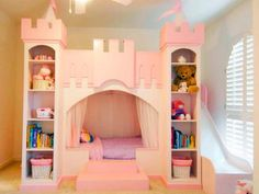 Every princess castle should come complete with its own slide. Truly living in a castle of her own, a little girl finds everything she wants in this all-in-one piece of furniture that also features storage shelves, a bed and play loft. Design by RMSer NeverlandThemeBeds