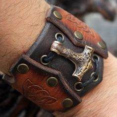 This is a real solid bronze hand-crafted antique finish pendant and handmade genuine leather bracelet. The two-in-one bracelet and pendant: you can wear them together as a bracelet or wear the leather bracelet and bronze pendant separately. The pendant is Thors hammer, or Mjolnir, – a very powerful Nordic protective amulet, a symbol of the creative powers of man. It is a really powerful shield from any negative energy channeled towards the owner of the pendant and also carries great support…