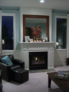 This looks like my fireplace area, only there isn't enough space for mantle sides!  Our large mirror is stuck to the wall. Need to remove + put up a framed mirror and a real mantle for decor.