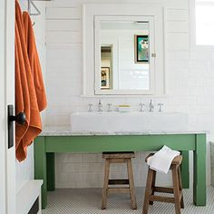 love the farm sink with clean white detailings and a great green base.