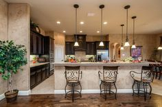 Bar-style kitchen dining seems to be a popular choice for a Lillian Custom Homeowners. Do you enjoy your breakfast meals at the bar or at the kitchen table?