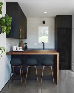 Loving every detail of this design by for including a stunning walnut waterfall counter and our Wildwood Sconce in matte black. Black Kitchen Cabinets, All White Kitchen, Black Kitchens, Home Kitchens, Small Kitchens, Kitchen Ideas For Small House, Small Kitchen Bar, Walnut Kitchen, Kitchen Post