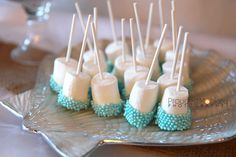"Marshmallow pops dipped in ""sea pearls"""