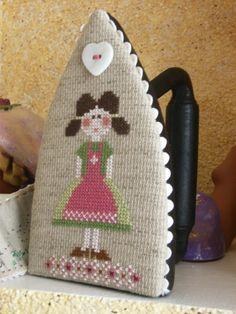 Muñequita en plancha de   (no idea what this says but cute idea if you can find a vintage iron)