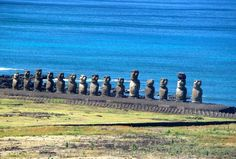 Easter Island. Moai facing inland at Ahu Tongariki. They were restored by Chilean archaeologist Claudio Cristino in the 1990s. The second moai from the right has a pukao on its head. The fifth moai from the right is the tallest moai on the island.