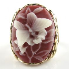 Butterfly Cameo Ring     Lovely and large 18x25mm oval shaped molded resin fashion Cameo hand sculpted in the finest Jeweler's 14K Rolled Gold custom designed setting.    Raised white butterfly agains