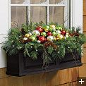 Martha Stewart Battery-operated Christmas Ornament Window Box Filler from Grandin Road.  Lifelike sprigs of various evergreens are arranged with birch twigs and natural pinecones.  Accented with clusters of shiny red, green, silver, and gold shatterproof ball ornaments.   Could also create similar look using whatever color ornaments & design match theme & decor.