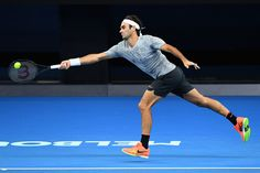 Roger Federer Photos Photos - Roger Federer of Switzerland plays a forehand during a practice session ahead of the 2017 Australian Open at Melbourne Park on January 15, 2017 in Melbourne, Australia. - 2017 Australian Open - Previews