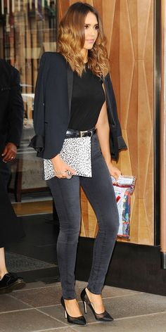 Jessica Alba in a black t-shirt tucked into belted high-waisted skinny jeans, a black blazer, accessorized with black pumps and a leopard clutch