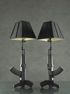 """These are hand made slip-cast ceramic lamps.   Each lamp stands 24"""" to the fixture and a total of 33"""" tall to the top of the shade.  The surface is a semi-matte glaze showing off the elaborate detail of each gun.  Comes with fixture, shade, cord and plug.."""