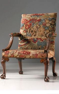 A pair of George II walnut library armchairs in the manner of Giles Grendey circa 1745