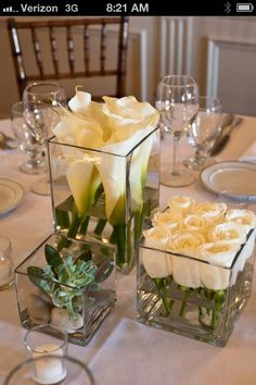 Red roses instead of white, with silver or white satin wrapped around the stems inside the jar.