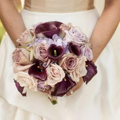 bouquet of eggplant-colored mini calla lilies, lavender-colored roses and hydrangeas had an antique look