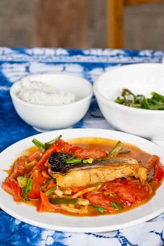 An authentic #beer #Fish recipe learned at a cooking school in Yangshuo #China. Easy to make with a delicious tomato beer based sauce. #dairyfree