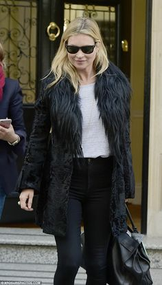 She's so super: Kate Moss was pictured leaving some London offices on Tuesday, where she showed off her style in her trademark skinny jeans