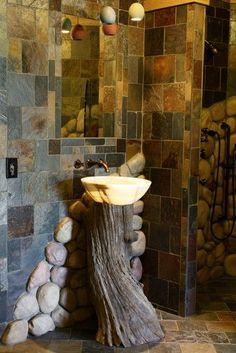 Onyx Sink on Tree Stump  ~    This onyx vessel bowl sink rests upon a reclaimed tree stump.  From Architectural Justice