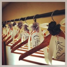 Treat your Bridesmaids Perfect DIY project for cosmetic purposes. The darker colored flowers could be for the Maid of Honor. But the beautiful tags and the bows are a beautiful touch, and wood hangers really pull the entire picture together. Diy Wedding Hangers, Bridesmaid Hangers, Wedding Favors Cheap, Wedding Crafts, Gifts For Wedding Party, Wedding Decor, Wedding Reception, Wedding Ideas, Bridesmaid Dresses
