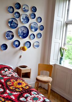 Bedroom – Old plates from Royal Copenhagen on the wall, chair by Alvar Alto, bedside table from Norrgavel - Lisa Grue of Underwerket - Via Design Sponge