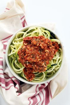 Zucchini Noodles with Fire Roasted Tomato and Crunchy Almond Pesto via Bustle