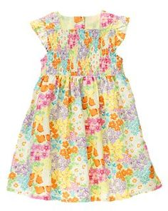 Gymboree: Flower Smocked Dress.  Adorable on.  We bought this dress a size larger and it fits great.