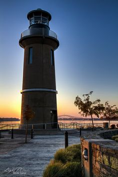 Lighthouse Sunset on Clover Island in Kennewick • by Steven Lamar.
