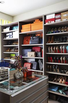Show off your designer collection with open-faced shelves. Courtesy Pinterest  - HarpersBAZAAR.com