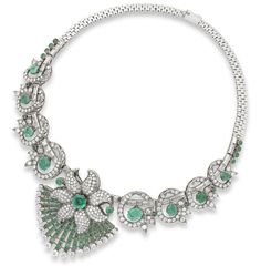 An emerald and diamond floral necklace, circa 1955.  The circular-cut emerald and brilliant-cut diamond flowerhead suspending a fan-shaped terminal of calibré-cut emeralds and brilliant-cut diamonds, to a baguette-cut diamond necklace entwined with brilliant-cut diamond scrolls, interspersed with oval and circular-cut emeralds, diamonds approximately 14.10 carats total, French assay mark, length 40.0cm
