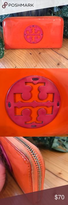 Tory Burch Stacked Patent Continental Wallet GUC. Bright orange and hot pink stacked patent leather Continental Wallet by Tory Burch. Gold Tory Burch logo zipper pulls. 8 card slots, multiple compartments for paper money or checkbook and zippered change purse. The inside is pristine but the outside does show some wear. There's some discoloration on the patent leather, some wear at the corners and some scuffing on the gold hardware but still an awesome, trendy wallet in a great color combo…