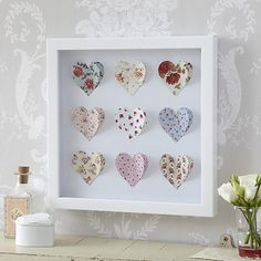 This is a pretty 3D paper art picture with nine teacups. This wall art is in a white box glass frame. These teacups have a chintzy look and will suit any shabby chic home. They will make a perfect present for your friends or loved ones.   Please note this picture is 4cm smaller than the other 2 this a price difference. .
