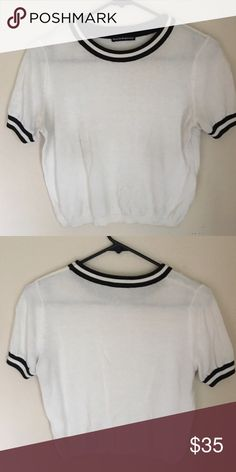 Brandy Melville varsity cropped sweater ONE SIZE. Worn only once. Sold out everywhere online and in store. Brandy Melville Tops Crop Tops