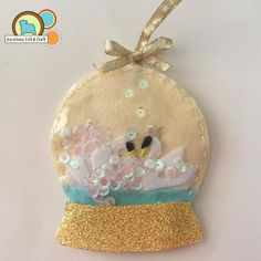 The tiny crowns are too cute! Christmas Traditions, Christmas Themes, Christmas Ornaments, Holiday Decor, Felt Diy, Felt Crafts, Magic Snow, Globe Ornament, Animal Projects