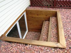 Egress window for basement. Just like this with different rocks :) sometime this month maybe?