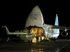 Antonov AN124 Ruslan being loaded with a Mi8 helicopter