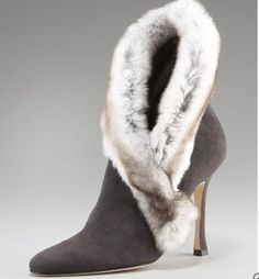 Manolo Blahnik  There's something about these...if I look at them long enough, I think I would be obsessed!!