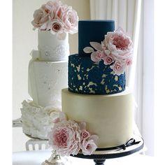 Navy wedding cake with gold. #wedding #weddingcake #sugarpeonies #sugarroses #goldandnavy #gumpasteroses #gold #lace #lesleamatsiscakes #roses #peonies #pink