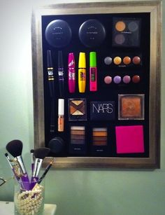 Creative Cosmetic Organization Solutions   Martha Lynn Kale for Camille Styles  Allows you to utilize your wall space so you can see all your makeup without digging around in a drawer. Just attach small magnets to the back of your makeup containers and they'll stick to a metal sheet.