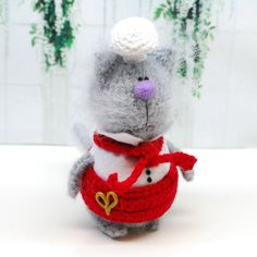 Chef Kitty is one of a kind amigurumi! It is grey kitty hand knitted from mohair wool yarn. It has white and red knitted apron and chefs white knitted hat! It has safety eyes and stuffed with non-allergic holofiber. Kitty is about 4.7 x 3 x 3  It was created in non smoking environment. Toy will arrive to you packed in a gift brown bag. Fast domestic shipping!  Welcome to Fuzzoo. You will find little cute amigurumi toys here, as well beautiful dolls for kids. Fuzzy amigurumi kitties and…