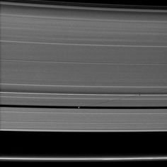 Saturn's small moon Pan casts a long shadow across the A ring in this image captured by the Cassini spacecraft a few days after the planet's August 2009 equinox.