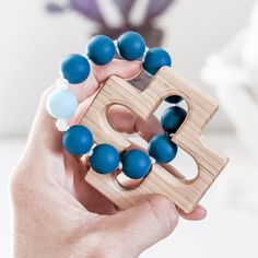 This rosary teething ring is handmade and the recipient was prayed for during its construction by the person that made it. The teal, rose gold, and pale blue are inspired by ocean themed colors in honor of Mary as Stella Maris. It makes a perfect Baptism gift for a baby girl or boy. The wooden cross is made by a local Catholic artisan. It is cut from durable maple wood, sanded smooth, and finished with a baby safe and food grade mineral oil/beeswax blend. The beads used are FDA approved food gra Catholic Baptism Gifts, The Good Catholic, Baby Safe, Christian Art, Mineral Oil, Shopping Mall, Our Lady, Food Grade, Art For Sale
