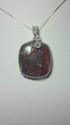 Check out this item in my Etsy shop https://www.etsy.com/uk/listing/472357954/wirework-crazy-lace-agate-pendant-gift