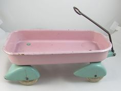 Adorable signed Wyandotte toy childs pink and aqua metal doll pull wagon for a girl. $95.00, via Etsy.