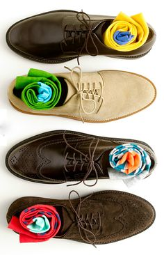 A selection of brown shoes and colourful socks