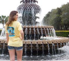 There is just something about this pineapple fountain that is perfect! This fountain in Charleston SC, and the many palm trees surrounding it are the inspiration for this Spring United Tee. #LiveTheAmericanDream #PineapplesAndPalmtrees